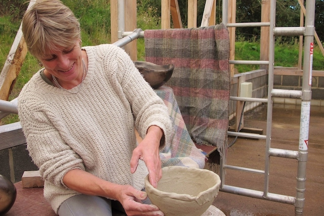 Wilma Allan adding another coil to a pot
