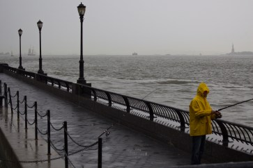 Fishing along the Hudson River during the rainstorm