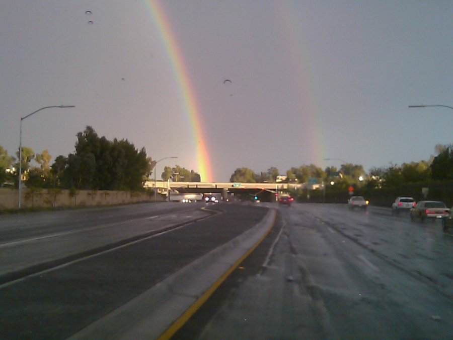 double rainbow at the end of the road