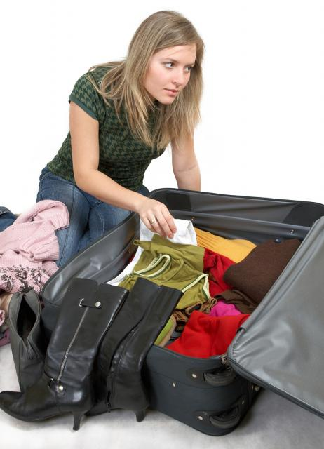 bigstockphoto_girl_is_packing_clothes_1561302.jpg