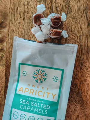 An overhead shot of Sweet Apricity sea salted caramels spilling out of the bag