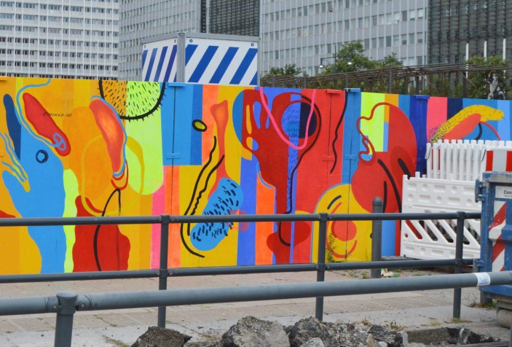 Mural by Carolina Amaya on construction site Berlin Alexanderplatz