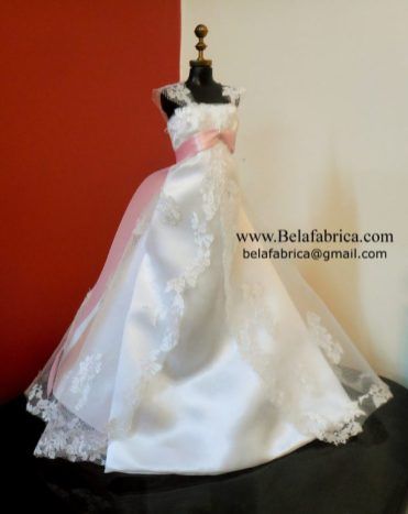 Alfred Angelo 1719W with veil and bouquet Miniature Replica along with a Pink Sash on a mannequin