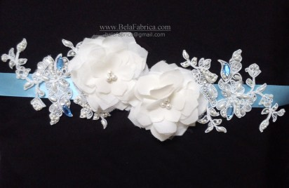 light blue wedding sash with flowers and lace