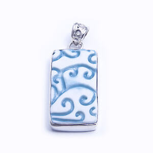 Felce a rectangular handmade porcelain pendant set in sterling silver. Available in four colours; light blue, blue, grey and red.