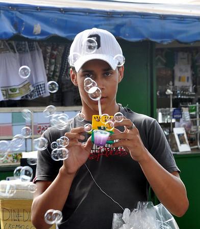 Street vendor.  Pretty cool kid.