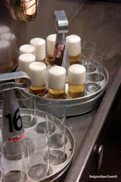 Trays filled with Kölsch beer in the typical 'stange' type of glass