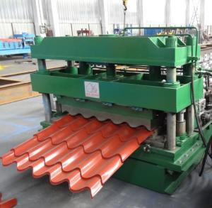 Punch and cutting device of tile roll forming machine