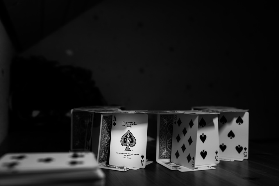 a flimsy house of cards in black and white (represents fragility of constructed imaged of self)