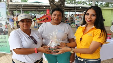 Mrs Ramirez receiving second prize on behalf of her husband Abel Ramirez from OW. The second prize was courtesy of Belizean Home made Jellies from the Cayo Dist.