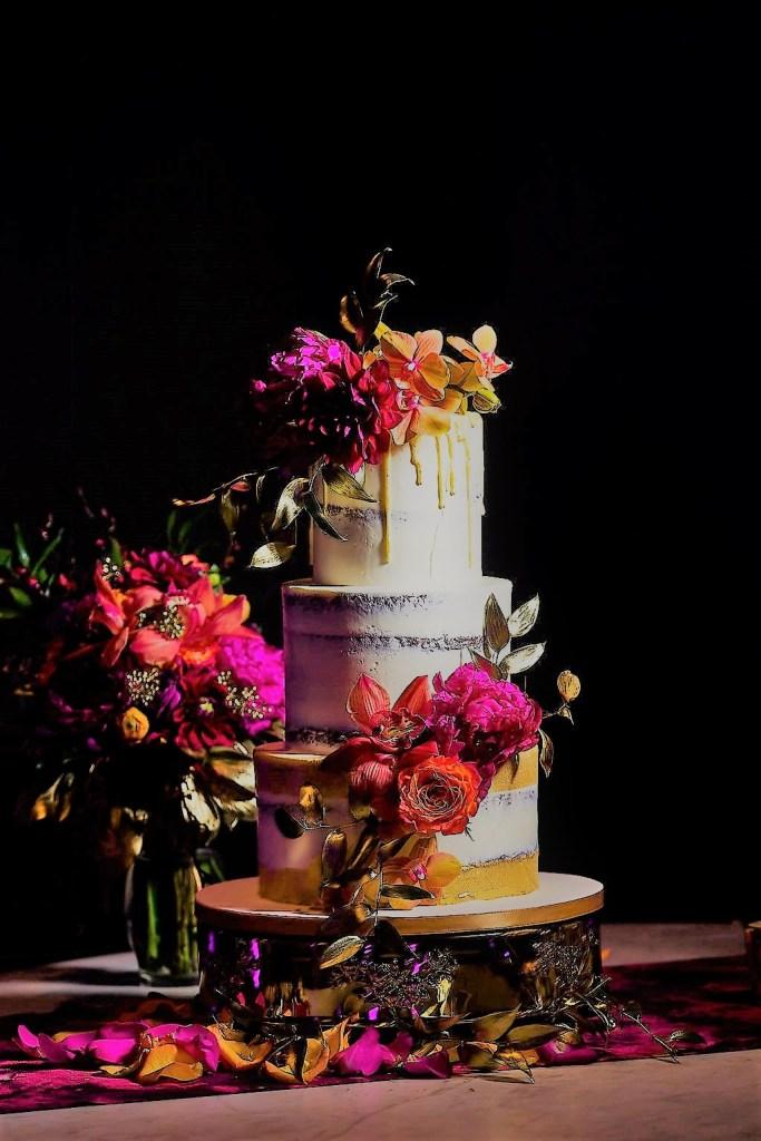 elegant wedding cake with pops of color