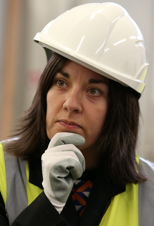 Scottish Labour deputy leader Kezia Dugdale looks on during a visit to a bricklaying workshop at New College Lanarkshire near Motherwell.