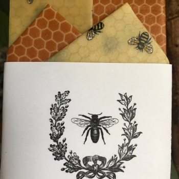 Honeycomb and Gold Glitter Bee print reusable beeswax food wraps in a Starter Pack containing four wraps
