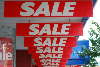 store sale signs photo