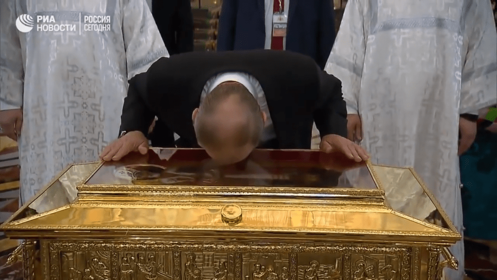 Screen capture of Vladimir Putin kissing the relics of St. Nicholas