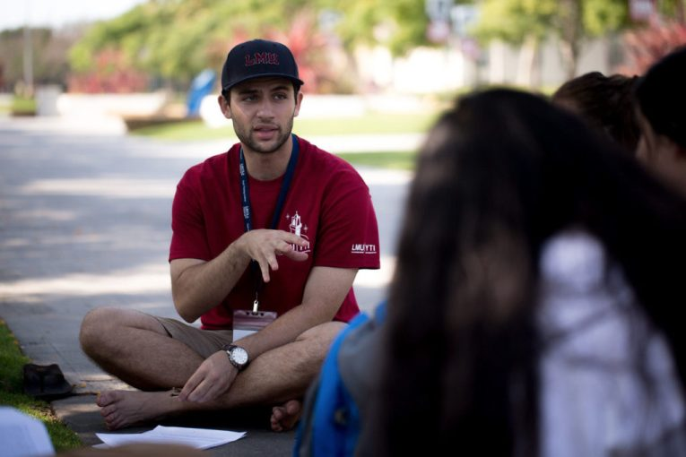 Mentor talking to students