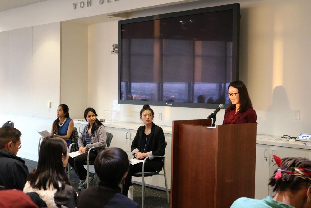 Yanjie Wang speaking at podium