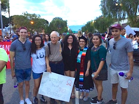 Cecilia Gonazalez-Andrieu with LMU alumni and artist John August Swanson at a pro-DACA march in downtown L.A.