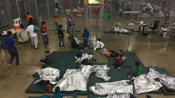 Children in foil sleeping bags at border control