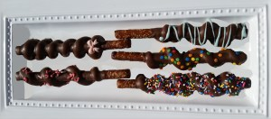 Chocolate and Caramel covered pretzel sticks, a perfect hostess gift and we ship!