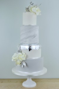 Multitiered modern wedding cakes come in a variety of colors and flavors