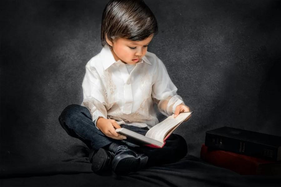 children portrait of filipino boy reading