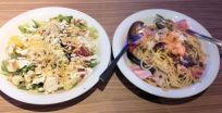Caesar salad with avocado and spaghetti with eggplants