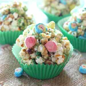 Make St. Patrick's Day even more fun with these yummy Popcorn Balls! They are full of sprinkles, marshmallow charms cereal, and are easy to make for St. Patrick's Day or any day of the year!