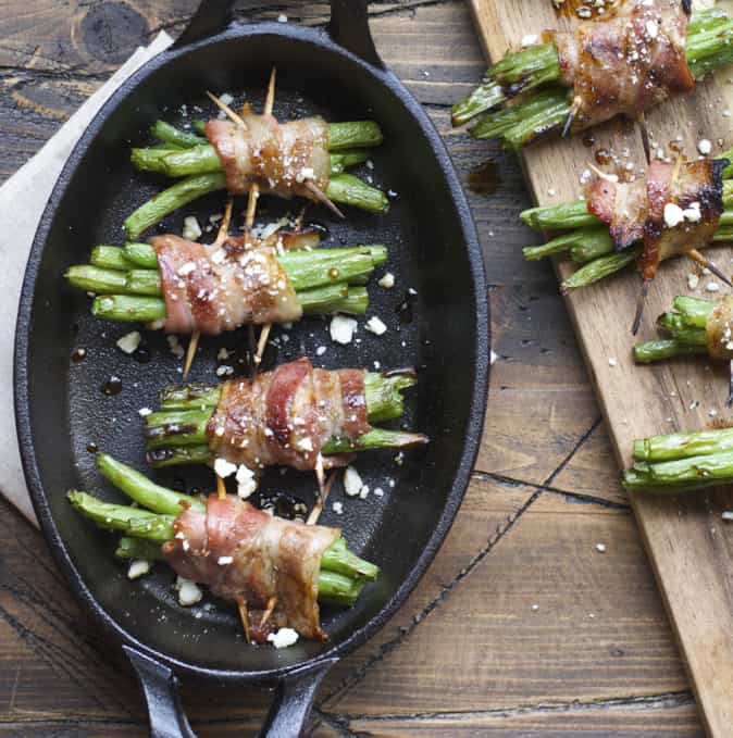 Tender green beans are marinated and wrapped in bacon, grilled to perfection and topped with tangy bleu cheese! This is an incredible Summer side dish you will love!