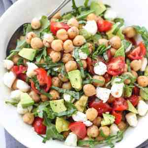 This Caprese Chickpea Salad is full of flavor and bursting with fresh ingredients like avocado, tomato, mozzarella, fresh herbs, and more. This makes a great vegetarian meal option for lunch or dinner thanks to the protein packed chickpeas.