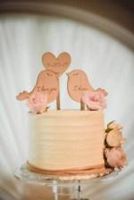 White buttercream wedding cake with bird cake topper- Dani Leigh Photography