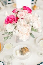 Low pink wedding centerpiece with hydrangeas and roses - Photography: Lauren Westra