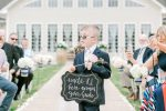 Ring bearer with sign - Photography: Lauren Westra