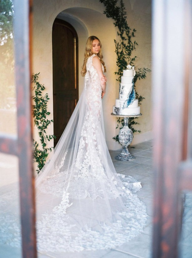 Lace mermaid wedding dress with cape and long train by Pronovias - Photography: The cablookfotolab