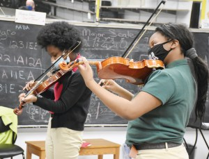 Students at Sister Thea Bowman School practice violin, which is a standard part of every student's curriculum. (Photo/Linda Behrens)