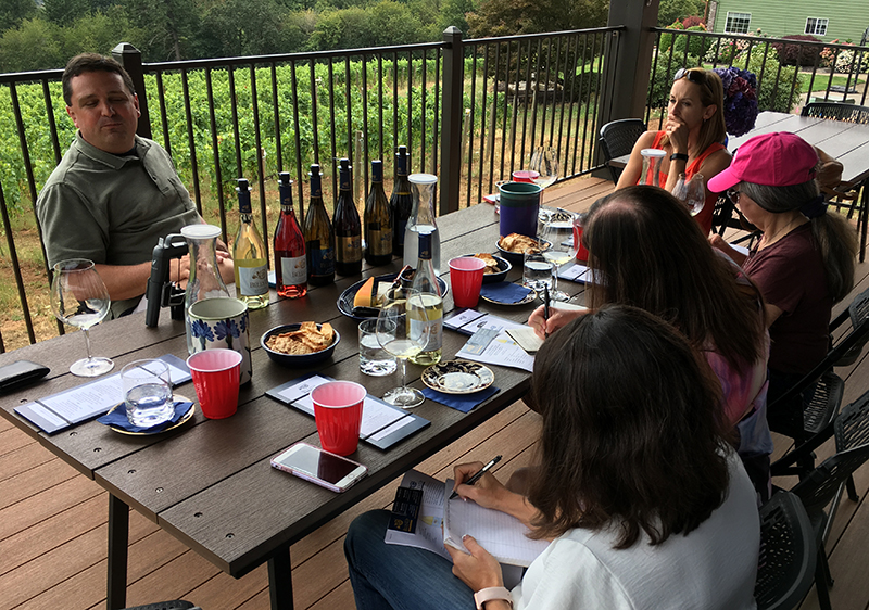 Photo of a seated wine tasting experience at Bells Up Winery