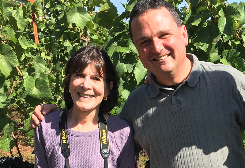 A woman and a man in a vineyard
