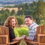 Couple holding hands overlooking a vineyard
