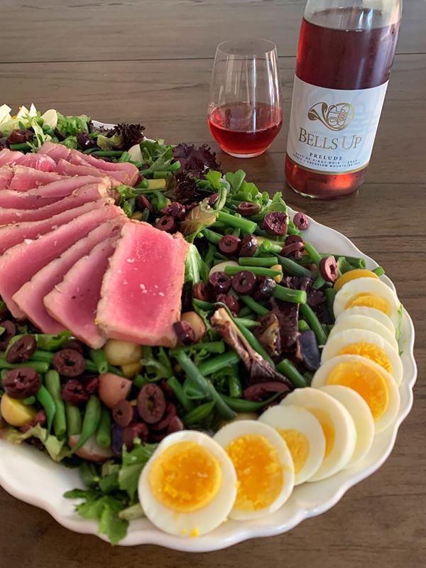 Nicoise salad with bottle of rosé wine