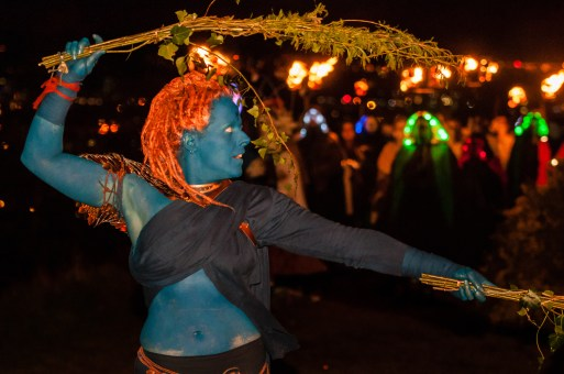 The Blues are the guardians and preservers of the rituals and traditions of our festivals. On the night of Beltane, they open and hold the space in which the May Queen comes to life, serving as guides and protectors of Her procession as She leads the Green Man to his death and rebirth, and the lighting of the Beltane Fire.   Photo by Dan Mosley for Beltane Fire Society.