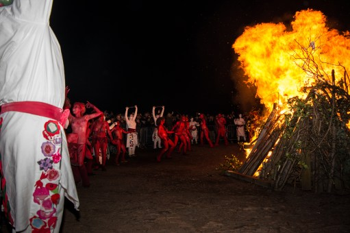 Together they light the Beltane bonfire | Photo by Pascal van der Meiden for Beltane Fire Society. All rights Reserved.
