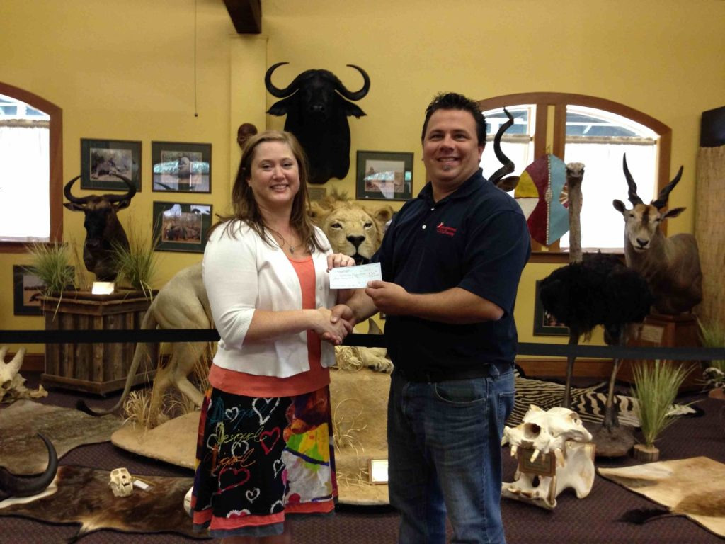 Matt Lusk presents a check to the Belton Museum Association from the South Carolina Chili Cookoff