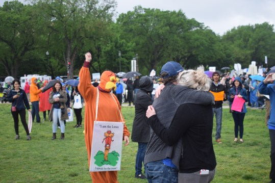 A man dressed as the Lorax cheers on the newly-engaged couple at the March for Science. (Photo by Cam Hasbrouck 4-22-17)