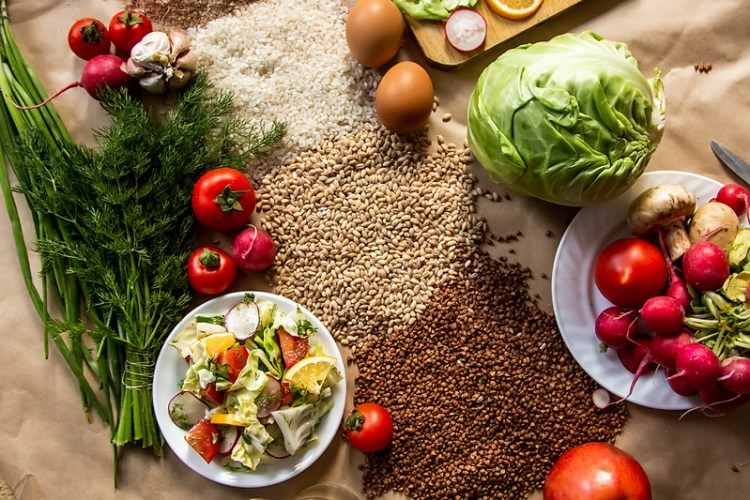 Healthy food background. Assortment of fresh vegetables and croups on paper background