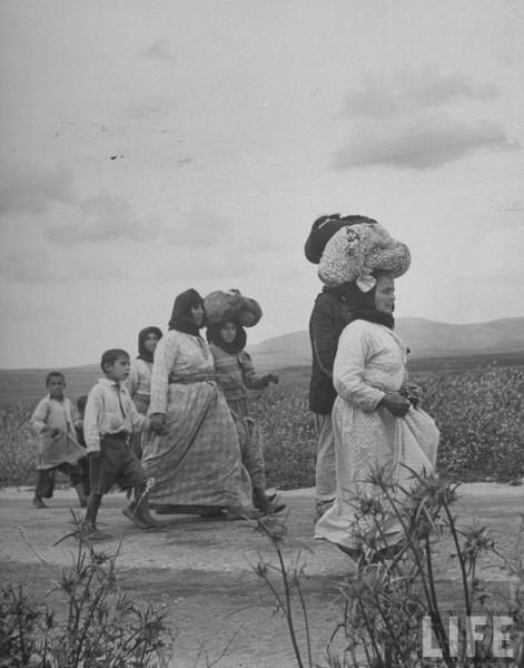 Women and children refugees evacuating the village of Zenin. May 1948. John Phillips