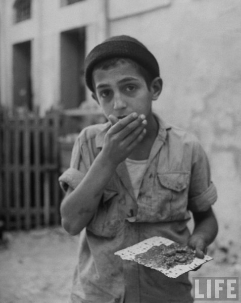 Jewish boy eating matzos, Jerusalem, June 1948, John Phillips