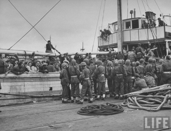 llegal Jewish immigrants aboard captured refugee ship surrounded by British troops who halted the craft shortly before the official creation of the state of Israel. Haifa 1948. Dmitri Kessel