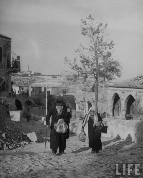 Elderly Jews going to Zion's Gate evacuation the Jewish quarter of Jerusalem. June 1948. John Phillips