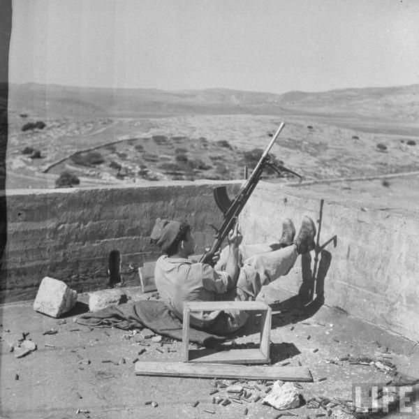Israeli soldier aiming his weapon. May 1948. Frank Scherschel