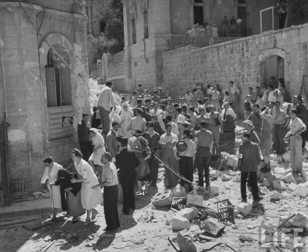 International Red Cross employees helping Jewish refugees. Jerusalem, Israel. June 1948. John Phillips